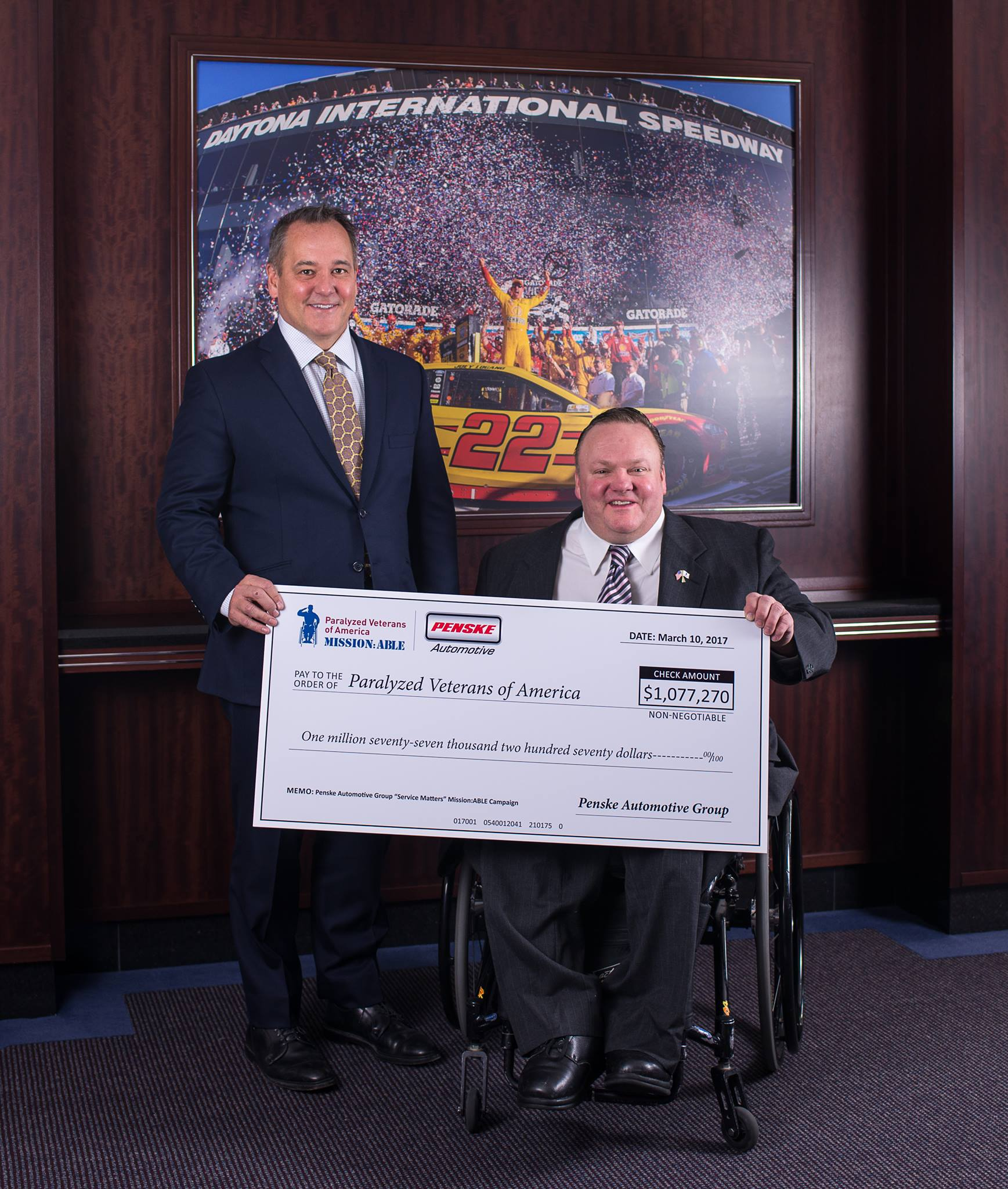 Rob Kurnick, President of Penske Automotive Group and Tom Wheaton, National Treasurer of Paralyzed Veterans of America.